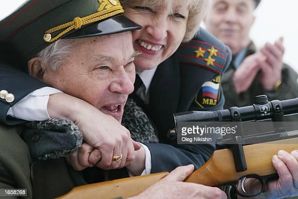 Police officer Tatiana Osetrova congratulates Mikhail Kalashnikov the father of the world's most popular assault rifle November 23 2002 in...