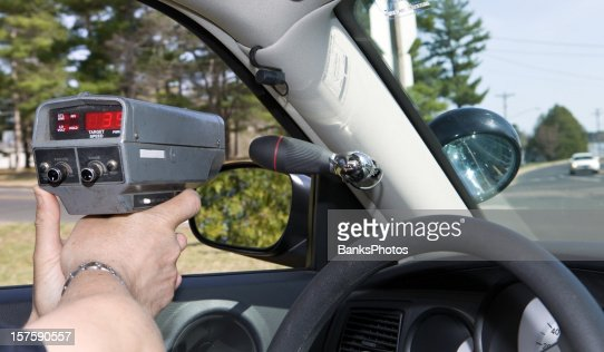 Police Officer Using a Handheld RADAR gun