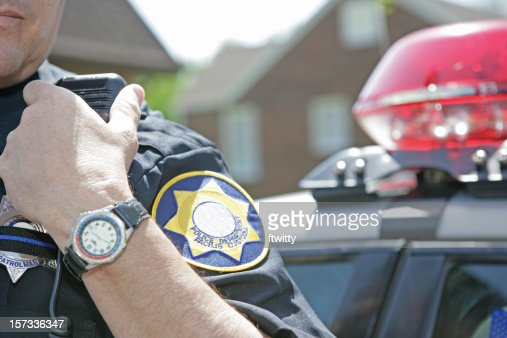 Police officer using radio to call for backup