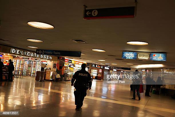 A police officer walks in an area where homeless people often congregate in Penn Station on January 28 2014 in New York City Over 3000 volunteers...