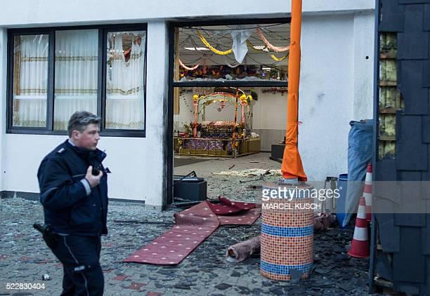 A police officer walks in front of the Sikh temple in Essen western German where an explosion took place at a wedding on April 16 2016 German police...