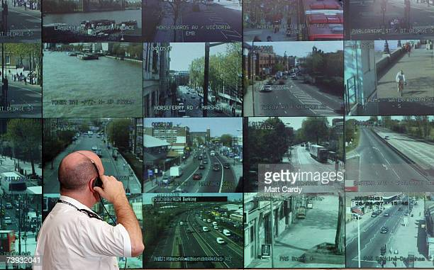 A police officer watches a bank television monitors showing a fraction of London's CCTV camera network in the Metropolitan Police's new Special...