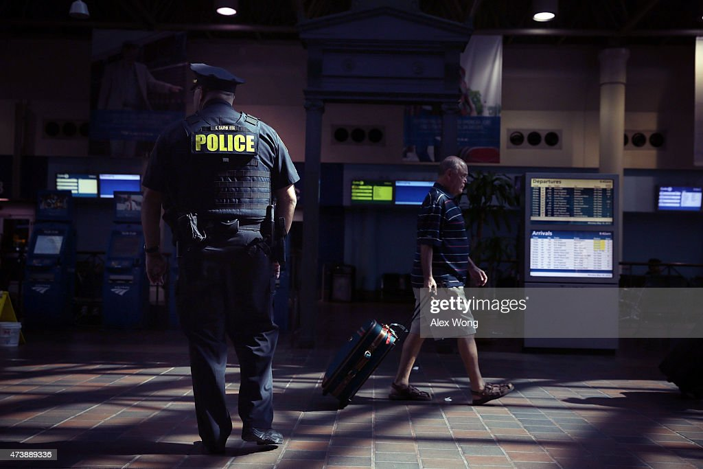 A police officer watches as a traveler walks by at Union Station May 18 2015 in Washington DC Amtrak has restored its normal service on the Northeast...