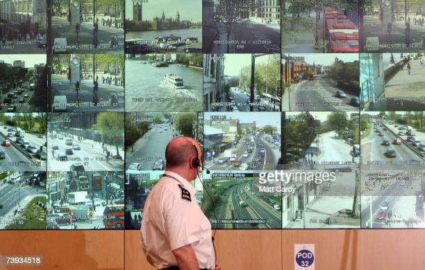 A police officer watches banks of television monitors showing a fraction of London's CCTV camera network in the Metropolitan Police's new Special...