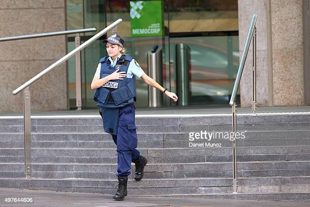 Police officer wearing a life vests leave 1 Oxford Street building on November 18 2015 in Sydney Australia Armed police stormed the office building...