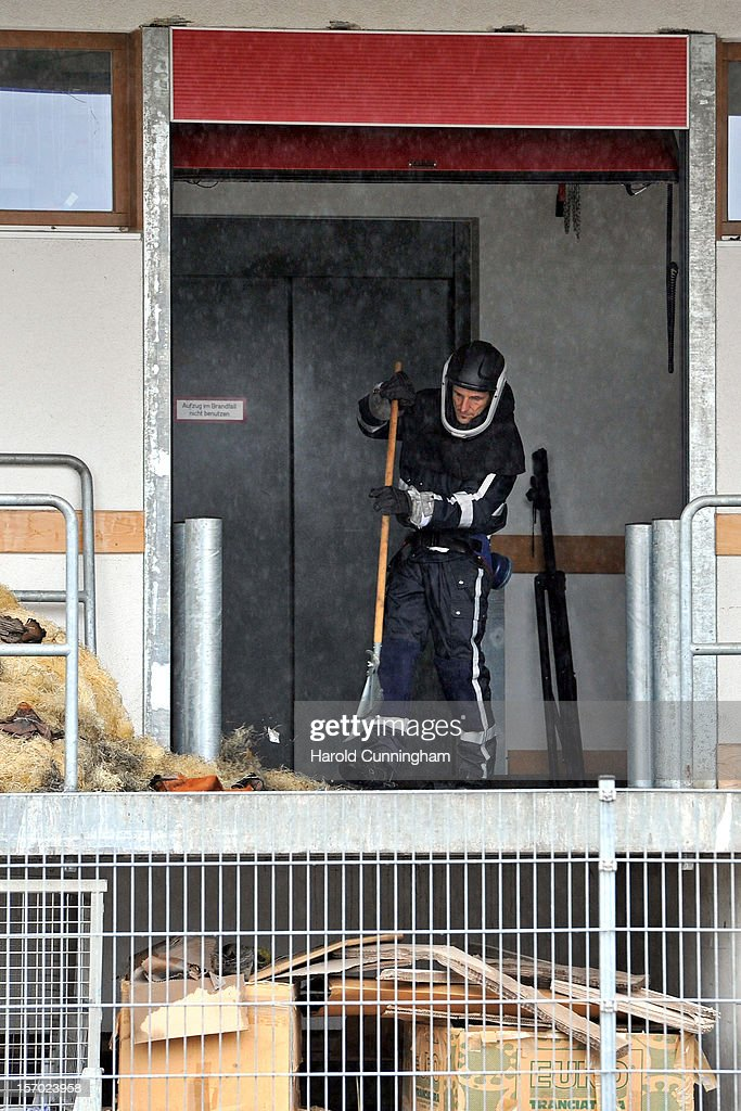 A police officer wearing a protective suit cleans parts of a Caritas employment facility for handicapped where a fire killed 14 people on November 27, 2012 in Titisee-Neustadt, Germany. The fire was reportedly caused by an explosion at the facility, where approximately 120 people with disabilities are employed in light manufacturing.