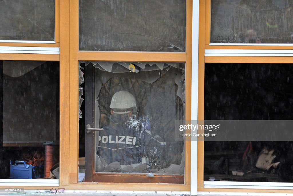 A police officer wearing a protective suit takes a picture inside a Caritas employment facility for handicapped where a fire killed 14 people on November 27, 2012 in Titisee-Neustadt, Germany. The fire was reportedly caused by an explosion at the facility, where approximately 120 people with disabilities are employed in light manufacturing.