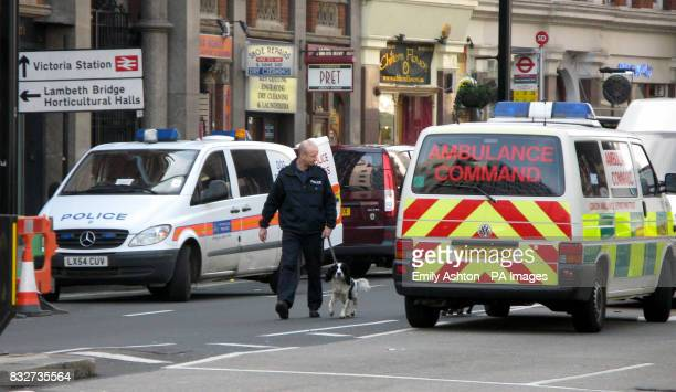 A police officer with a dog at Victoria Street in central London where a letter bomb exploded at an office less than a mile from the Houses of...