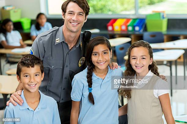Police officer with a group of school children