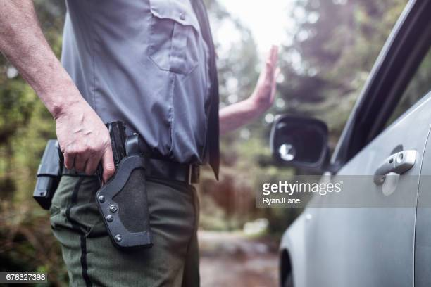 Police Officer With Hand on Weapon