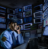 Police officer working in control room