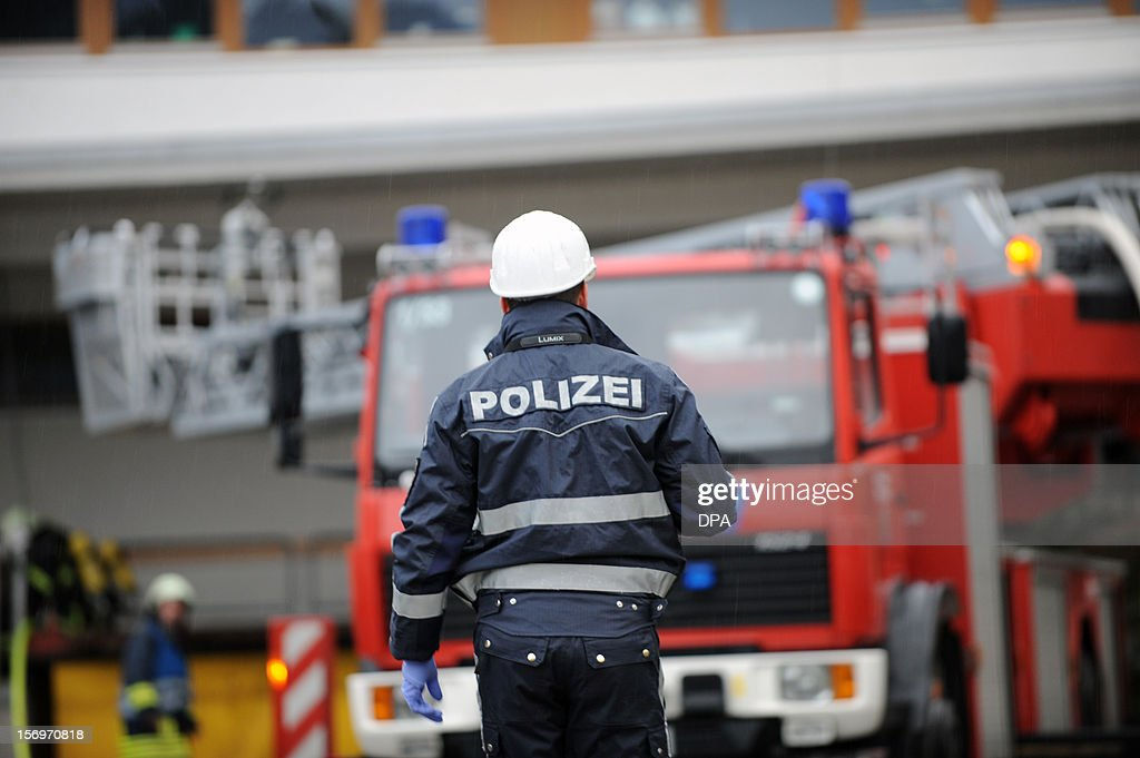 A police officer works at the scene of a fire at a workshop for handicapped people in Titisee- Neustadt, southern Germany on November 26, 2012. Fourteen people died after a fire broke out. AFP PHOTO / PATRICK SEEGER GERMANY OUT