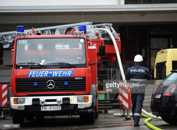 A police officer works at the scene of a fire at a workshop for handicapped people in Titisee Neustadt southern Germany on November 26 2012 Fourteen...