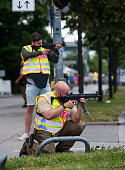 Police officers aim guns as they respond to a shooting at the Olympia Einkaufzentrum at July 22 2016 in Munich Germany According to reports several...