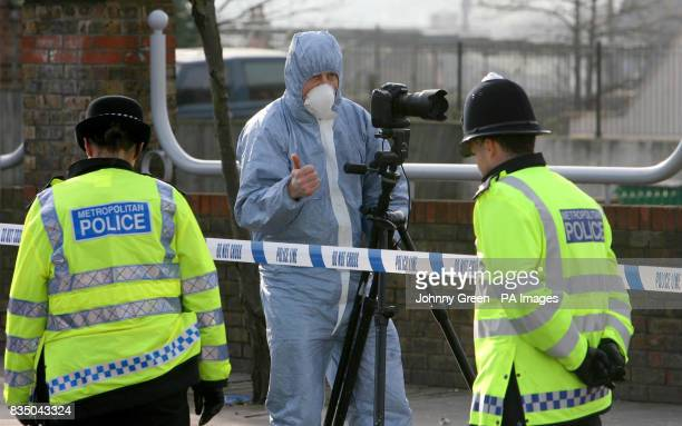 Police officers and a forensics officer at the scene of a murder on London Road in west Croydon south London after a 26yearold man was fatally...