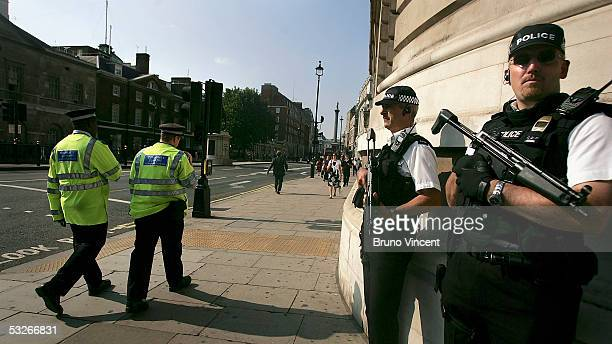 Police officers and community support officers are seen in Whitehall on July 21 2005 in London Three London underground train stations have been...