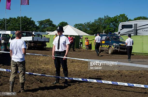 Police officers and Crime Scene Investigators attend the scene where a man's body was reported to have been found in the VIP 'winnebago' area...