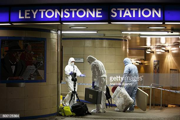 Police officers and crime scene investigators investigate a crime scene at Leytonstone tube station in east London England on December 05 2015 after...