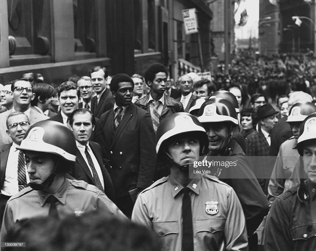 Police officers and crowds during the Hard Hat Riot in Lower Manhattan, New York City, 8th May 1970. The riot occurred when construction workers mobilised by their labour union attacked a student protest rally, which was being held in the wake of the Kent State shootings four days previously.