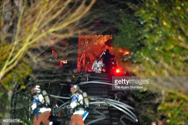 Police officers and fire brigade members extinguish fire at Kodaiji temple on February 17 2015 in Kyoto Japan A nighttime fire destroyed a building...