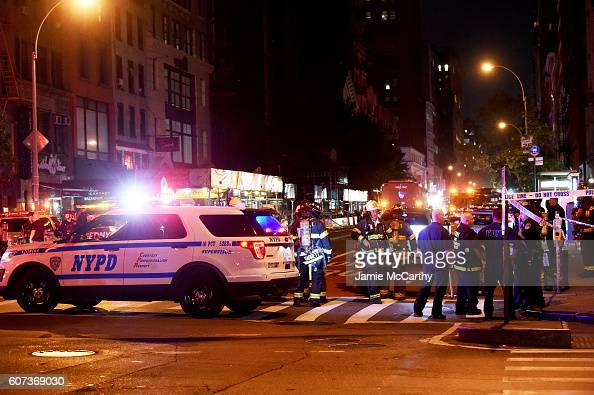 Police officers and firefighters respond to an explosion on September 17 2016 at 23rd Street and 7th Avenue in the Chelsea neighborhood of New York...