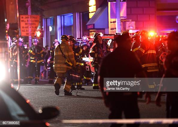 Police officers and firefighters respond to an explosion on September 17 2016 at 23rd Street between 6th and 7th Avenues in the Chelsea neighborhood...