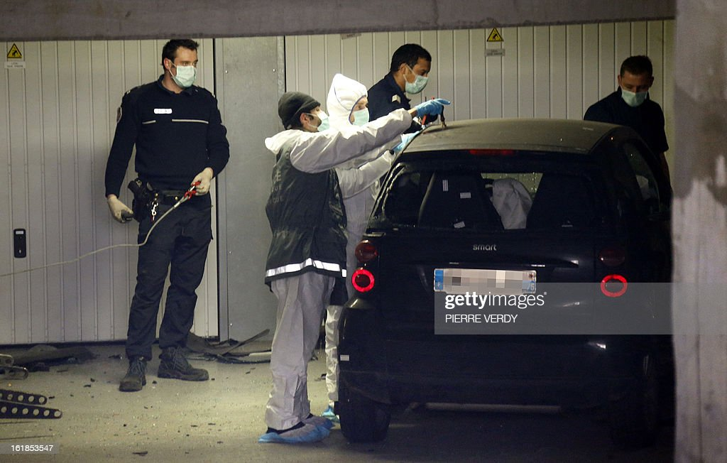 Police officers and forensic experts search for evidence around a car on February 17, 2013 in Montrouge, a southern Paris suburb, after a 20-year old woman was seriously wounded in her vehicle by gun shots.