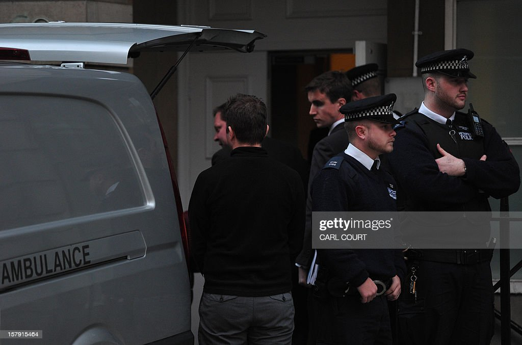 Police officers and hospital staff stand by the rear of a coroners van as a body is loaded inside outside a nurses accommodation block near the King Edward VII hospital in central London on December 7, 2012 where nurse Jacintha Saldanha was found dead. A nurse at the hospital which treated Prince William's pregnant wife Catherine, Duchess of Cambridge, was found dead on December 7, days after being duped by a hoax call from an Australian radio station, the hospital said. Police said they were treating the death, which happened at a property near the hospital, as unexplained.