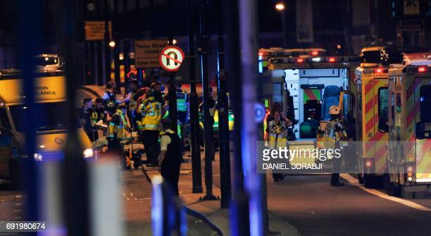 Police officers and members of the emergency services work at the scene of a terror attack on London Bridge in central London on June 3 2017 Armed...