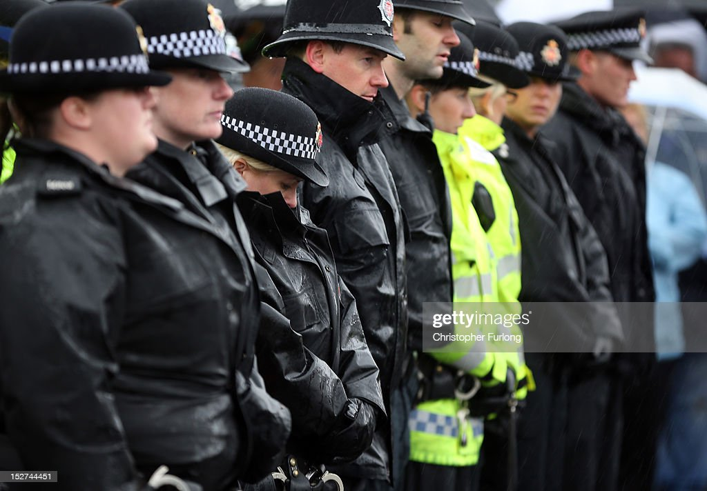 Police officers and members of the public take part in a memorial vigil at the scene where PC Nicola Hughes and PC Fiona Bone were murdered one week ago, in Mottram on September 25, 2012 in Manchester, England. Members of the public joined police officers in a walk in heavy rain from Hyde police station to the scene of the killings, for a vigil of prayers and reflection. Dale Cregan, 29, appeared before Manchester Magistrates last week accused of four murders, including those of PC Nicola Hughes and PC Fiona Bone on September 18, and also in two separate attacks earlier this year on Mark Short and his father David Short. Cregan is also being charged with an additional four counts of attempted murder.