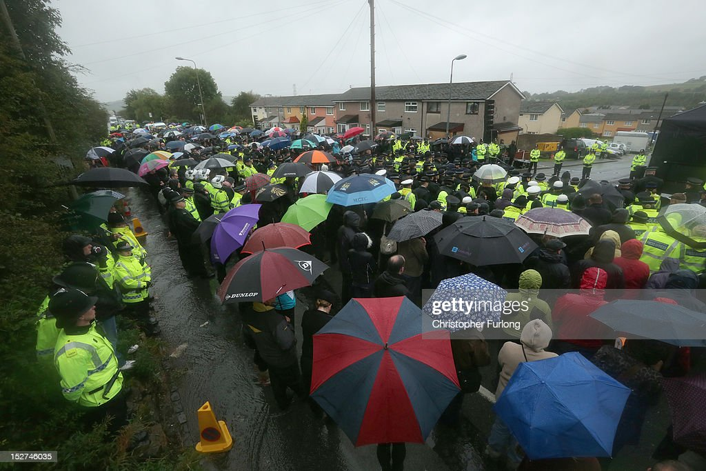 Police officers and members of the public take part in a memorial vigil at the scene where PC Nicola Hughes and PC Fiona Bone were murdered one week ago, in Mottram on September 25, 2012 in Manchester, England. Members of the public joined police officers in a walk from Hyde police station to the scene of the killings, for a vigil of prayers and reflection. Dale Cregan, 29, appeared before Manchester Magistrates last week accused of four murders, including those of PC Nicola Hughes and PC Fiona Bone on September 18, and also in two separate attacks earlier this year on Mark Short and his father David Short. Cregan is also being charged with an additional four counts of attempted murder.