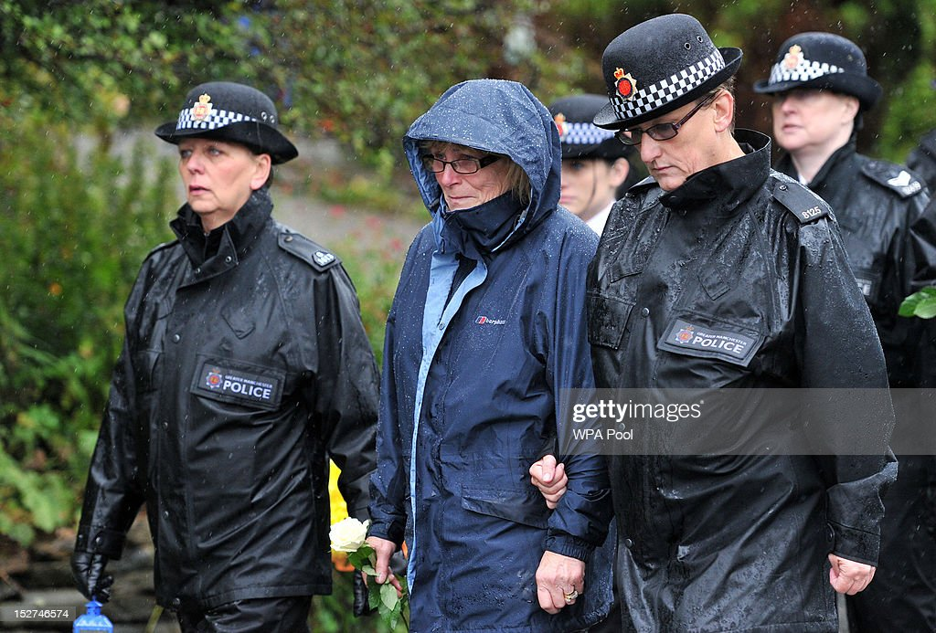Police officers and members of the public walk to the scene where PC Nicola Hughes and PC Fiona Bone were murdered one week ago, for a memorial vigil on September 25, 2012 in Manchester, England. Members of the public joined police officers in a walk from Hyde police station to the scene of the killings, for a vigil of prayers and reflection. Dale Cregan, 29, appeared before Manchester Magistrates last week accused of four murders, including those of PC Nicola Hughes and PC Fiona Bone on September 18, and also in two separate attacks earlier this year on Mark Short and his father David Short. Cregan is also being charged with an additional four counts of attempted murder.