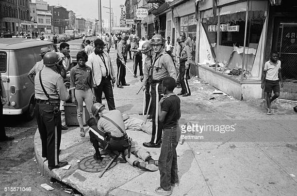 Police officers and National Guardsmen round up looters on a major thoroughfare following a second night of rioting in Newark New Jersey The violent...
