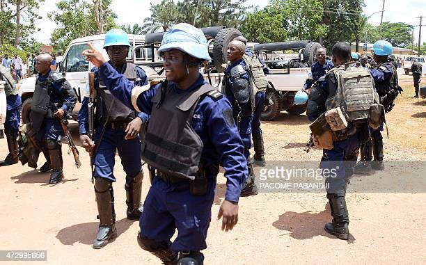 Police officers and peacekeepers deploy as people take part in a protest in front of the transitional parliament on May 11 2015 in Bangui to demand...