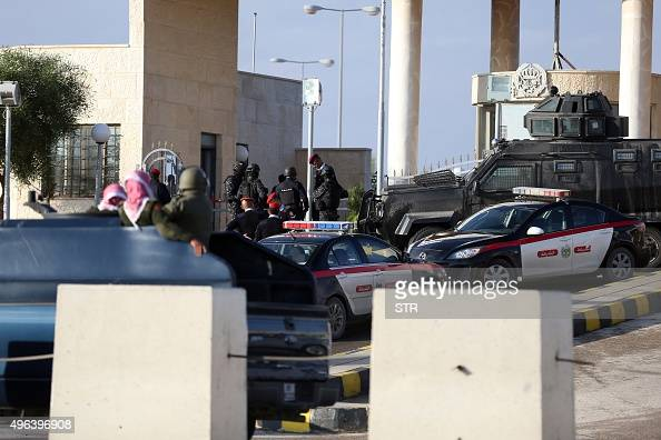 Police officers and security forces stand guard outside a police training centre east of Amman on November 9 where a Jordanian officer shot dead two...