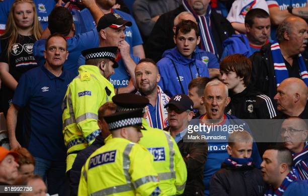 Police officers and stewards go into the Linfield supports section as tempers flare during the UEFA Champions League Qualifying Second Round Second...
