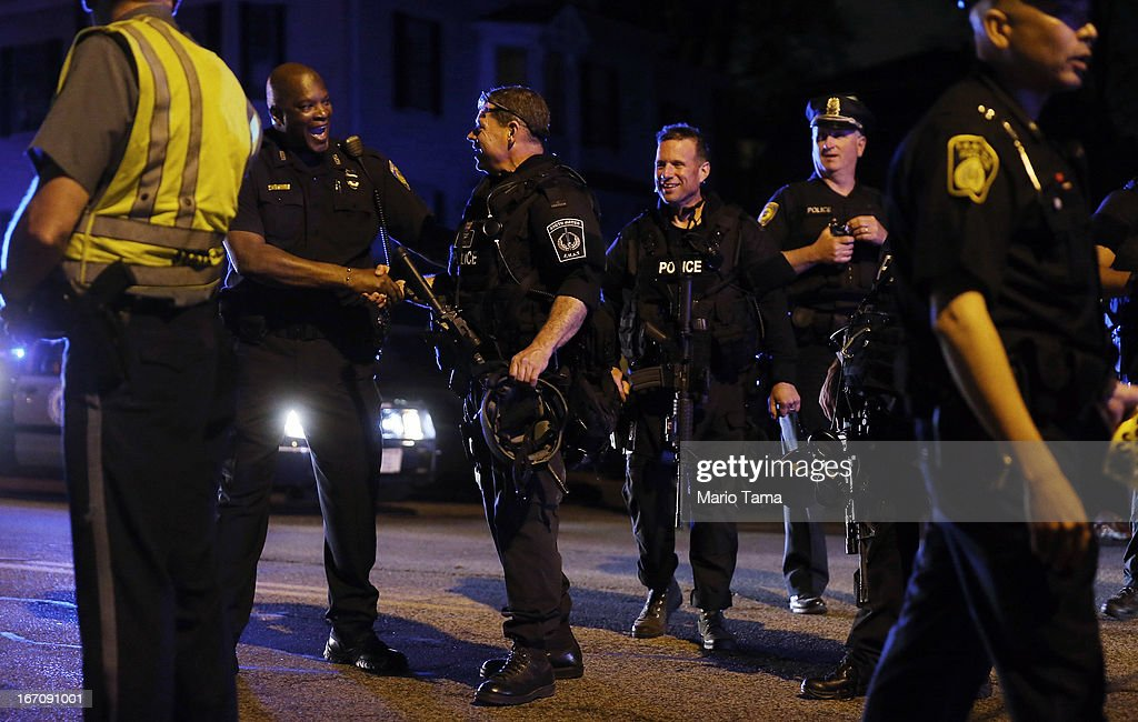 Police officers and SWAT team members celebrate after the successful operation to capture 19yearold bombing suspect Dzhokhar A Tsarnaev on April 19...