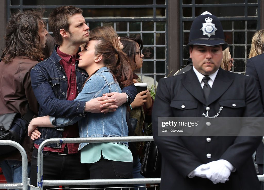 Police officers and well-wishers line the route in Southwark as the funeral procession of PC Keith Palmer makes its way to Southwark Cathedral, on April 10, 2017 in London, United Kingdom. A Full Force funeral is held for PC Keith Palmer who was killed in a terrorist attack in Westminster whilst on duty on March 22, 2017. The funeral is attended by his family, including his wife and child, and officers from the Metropolitan Police who served alongside him. Officers from the wider service across England and Wales also attend to honour their fallen colleague.