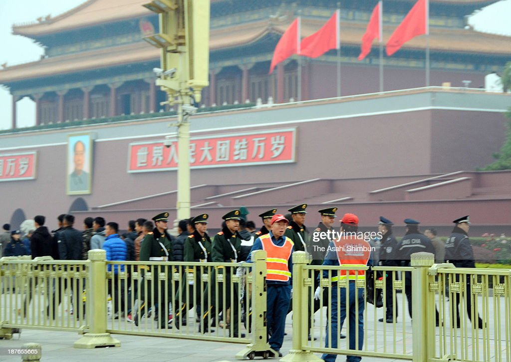 Police officers are deployed at Tiananmen Square ahead of the third plenary session of the 18th Central Committee of the Chinese Communist Party on November 9, 2013 in Beijing, China.