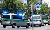 Police officers are parked near the McDonalds at the shopping center as they respond to a shooting at the Olympia Einkaufzentrum at July 22 2016 in...