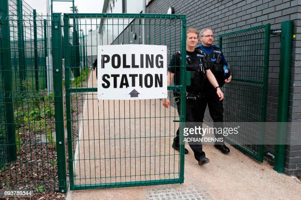 Police officers are pictured at a polling station at a sports centre in Fleet west of London on June 8 as Britain holds a general election Britain...