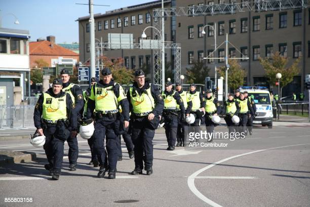 Police officers are pictured prior to the farright Nordic Resistance Movement march in Gothenburg Sweden on September 30 2017 AGENCY / Adam IHSE /...