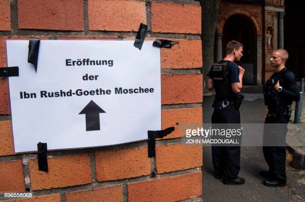 Police officers are posted at the entrance of the Ibn RushdGoethemosque in the St Johannis Protestant church in Berlin on June 16 2017 Founded by...