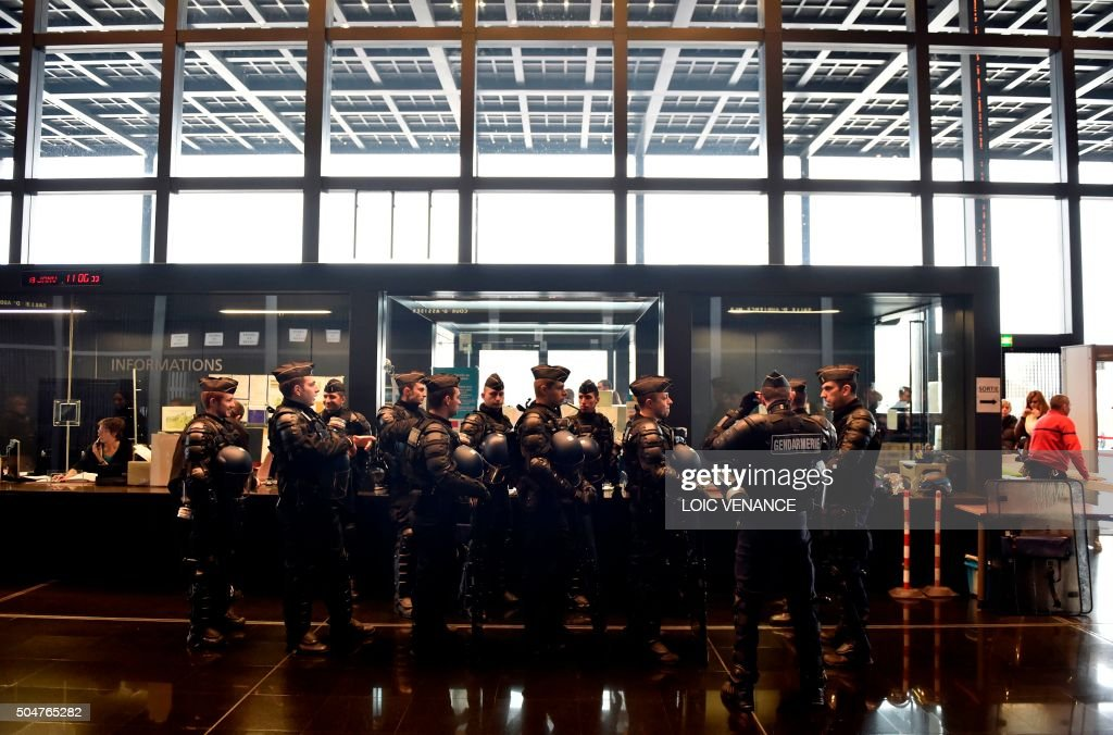 TOPSHOT Police officers are seen ahead of a hearing of families threatened of expulsion from the NotreDamedesLandes area where the future Nantes...