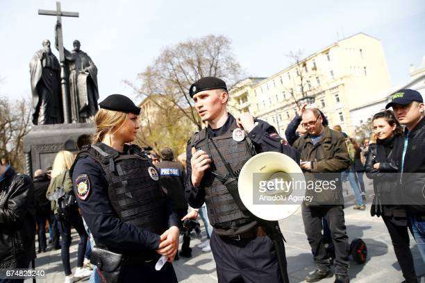 Police officers are seen before an unsanctioned protest against Russian President Vladimir Putin in Moscow Russia on April 29 2017