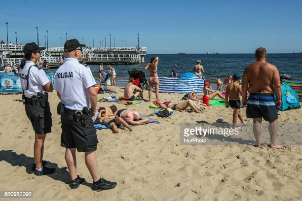 Police officers are seen on the Baltic Sea beach in Gdansk Poland on 22 July 2017 Gdansk Pomeranian County Police Command plans to create the Water...