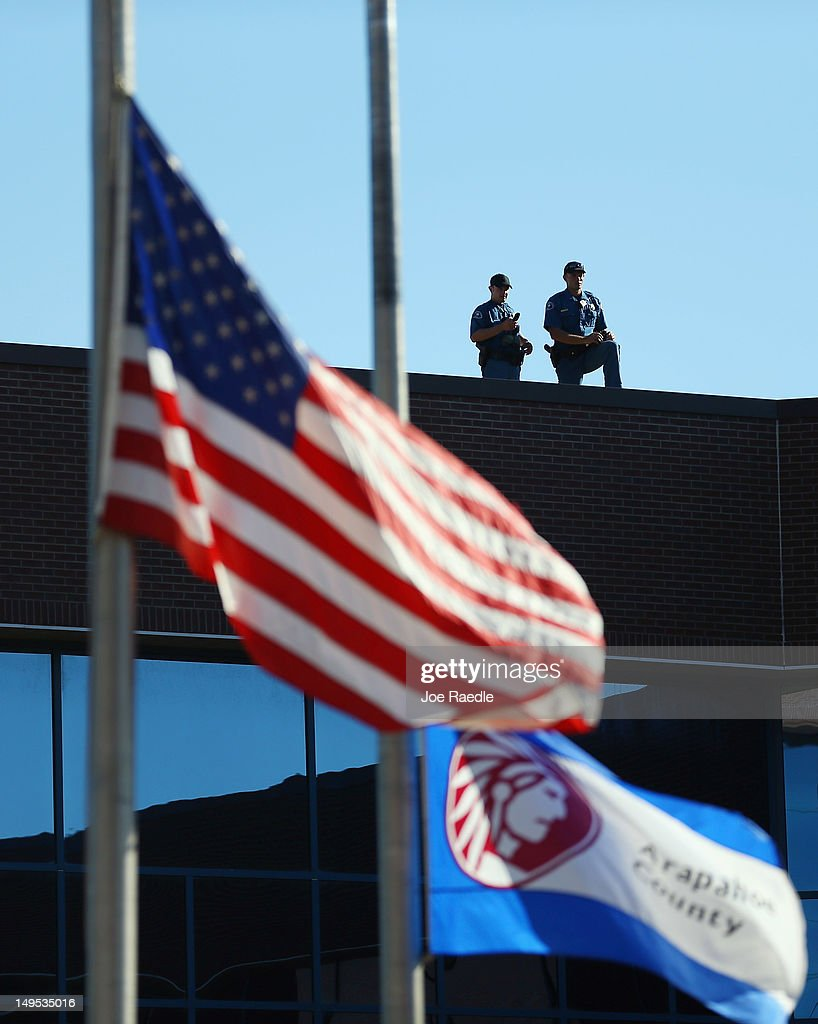 Police officers are seen on the rooftop at the Arapahoe County Courthouse for suspect James Holmes' arraignment hearing July 30, 2012 in Centennial, Colorado. James Holmes, 24, who is accused of killing 12 people and injuring 58 in a shooting spree July 20, during a screening of 'The Dark Knight Rises.' in Aurora, Colorado.