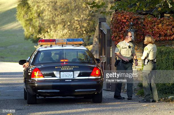 Police officers are shown at Michael Jackson's Neverland Ranch November 18 2003 outside of Santa Barbara California Police armed with a search...