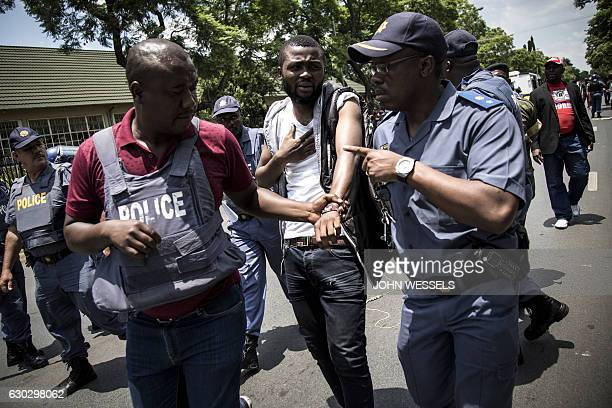 Police officers arrest a Congolese protester after a protest against the Democratic Republic of the Congo President Joseph Kabila outside the DRC's...