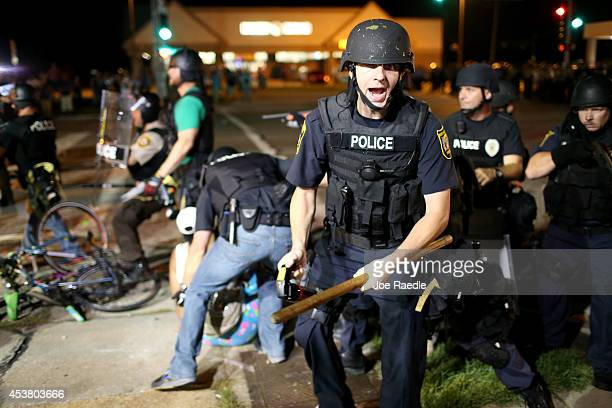 Police officers arrest a demonstrator on August 18 2014 in Ferguson Missouri Violent outbreaks have taken place in Ferguson since the shooting death...